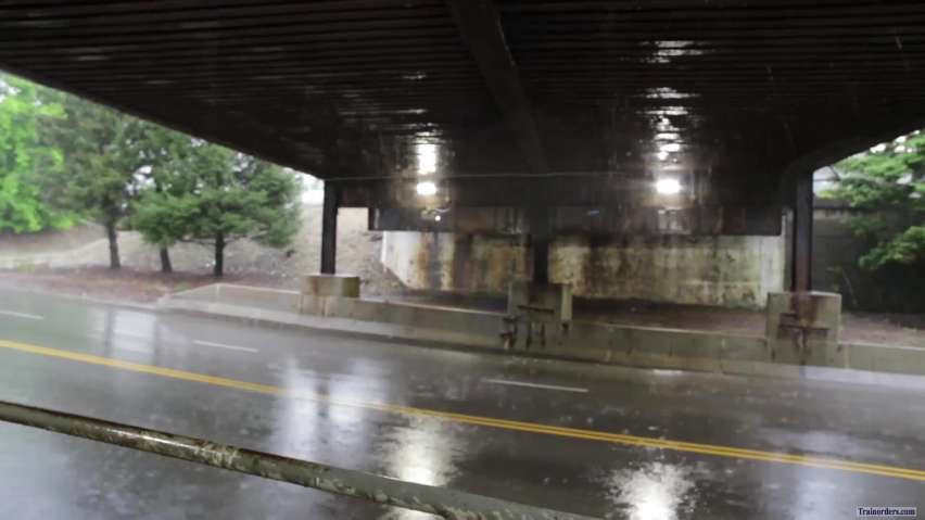 IC SD70's in Chicago; getting soaked under a rusty CN bridge