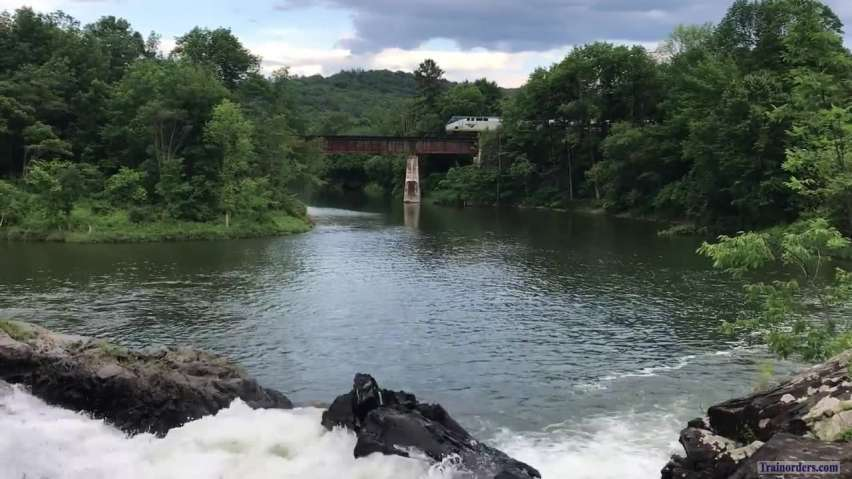 Amtrak passing a waterfall
