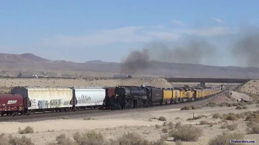 4014 overtaking a BNSF mixed freight coming out of Barstow