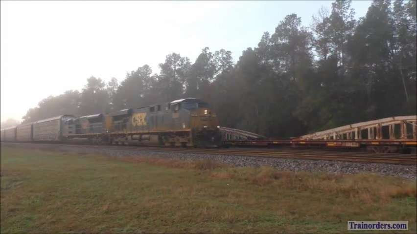 An ST70AH escapes Florida & CSX manifest with a caboose